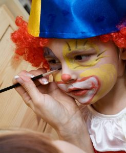 The boy wearing funny clown