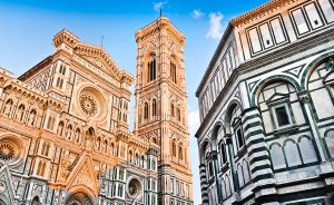 Famous Cathedral Santa Maria Del Fiore with Giotto's Campanile and Baptistery of St. John at sunset on Piazza del Duomo in Florence, Tuscany, Italy