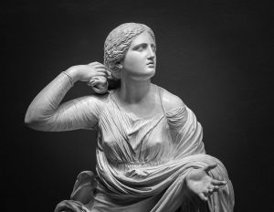 White marble statue of young woman.
