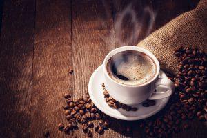 Cup coffee beans wooden dark background