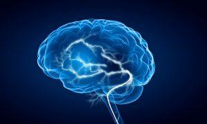 Shiny brain in between thunder lightning on dark background