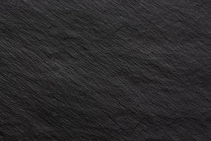 Dark black stone texture background for design