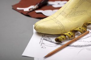 Modelling design of a shoes.Workplace of shoe designer Selective focus.Copy space.