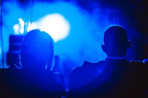 the viewer sits on the concert back, silhouette