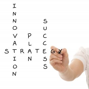 Hand solving a strategy plan to be successful in her business