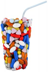 Glass shape assembled of pills with straw. Extralarge resolution. over white