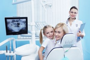 Mom with a child to the dentist in the clinic