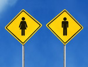 yellow male and female sign on sky background