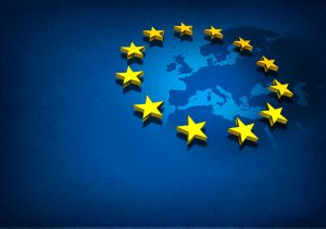 European Union and Europe countries including France Germany Italy and England surrounded by blue ocean with three dimensional yellow flag stars on a blue grunge background.
