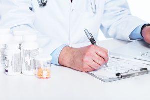 Medical doctor writing a prescription. Pharmacist.