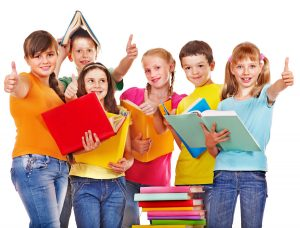 Group of teen school child with book.  Isolated.