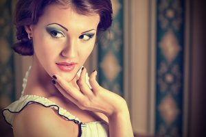 Portrait of beautiful young woman over vintage background.