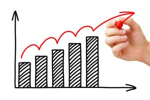 Male hand drawing Business Growth Graph with marker on transparent wipe board.
