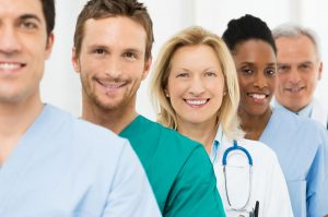 Group Of Happy Successful Doctors Standing In A Row At Hospital
