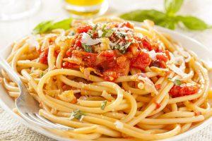 Homemade Bucatini Amatriciana Pasta with sauce and basil