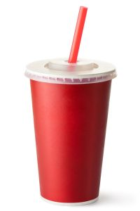 Red cardboard cup with a straw. Isolated on a white.