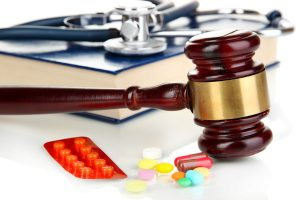 Medicine law concept. Gavel and pills close up