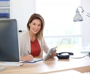 Businesswoman in office working with tablet