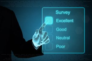business hand pushing survey on a touch screen interface
