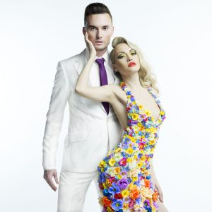 Fashion photo of young man and beautiful lady in flower dress
