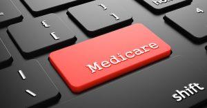 Medicare on Red Keyboard Button Enter on Black Computer Keyboard.