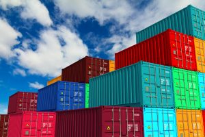 Multitiered of Colorful Cargo Containers on Sky Background. Logistics Concept.