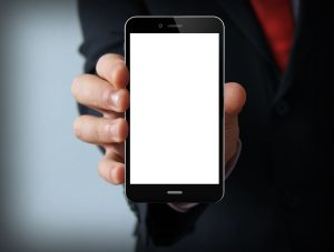 Male hand holding blank mobile smart phone
