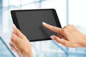 Tablet. Hands holding a tablet with isolated screen