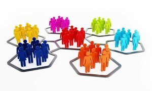 Multi-colored people in hexagonal shapes attached to each other