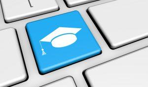 E-learning and online education concept with graduation hat icon and symbol on a blue computer key for school and online educational business.